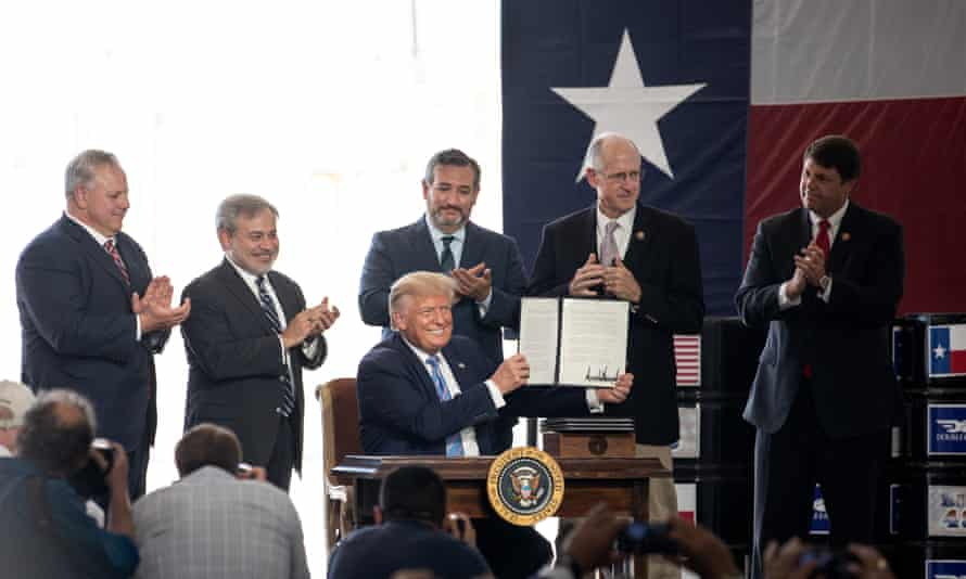 Donald Trump signs a permit at the site of Double Eagle Energy's oil rig in Midland, Texas, last month.