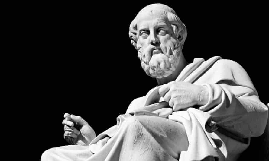 Marble statue of the ancient greek philosopher Plato in front of Academia- Athens, Greece.