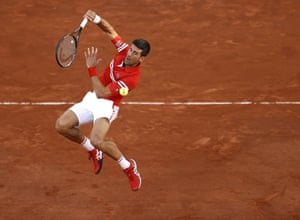A leaping Novak Djokovic returns to Rafael Nadal.