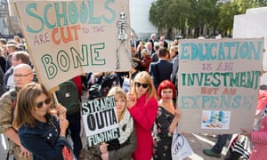Protesters hold banners in Parliament Square
