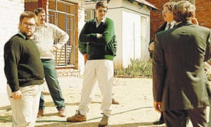 Eugene de Kock (centre), standing with police in front of a house in which he was said to have tortured and murdered apartheid opponents in the 1980s.