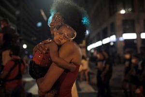 Washington, DC, US: a sleepy Bonita wears protective goggles as she settles into her mother's shoulder near the White House amid continuing anti-racism demonstrations after the killing of George Floyd by police