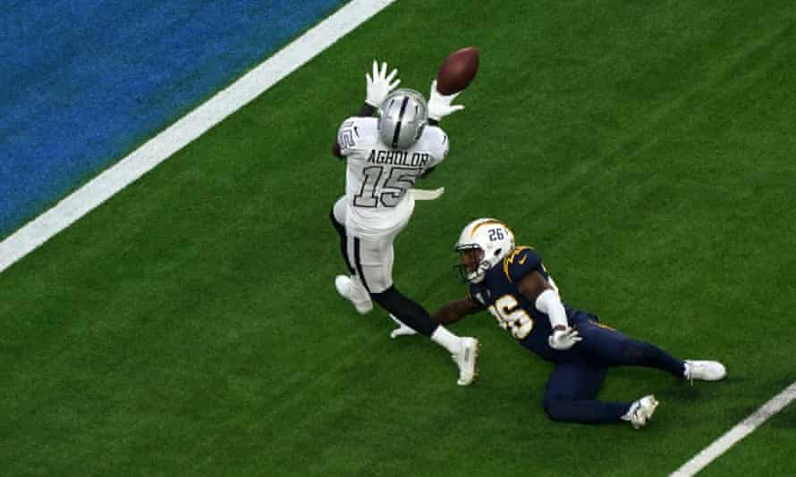 Las Vegas Raiders wide receiver Nelson Agholor (left) catches the ball against the LA Chargers.