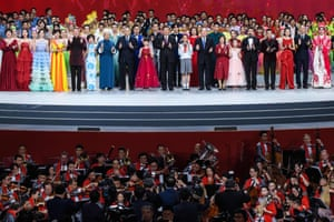 Macau, China President Xi Jinping, centre, the outgoing Macau chief executive, Fernando Chui, centre-left, and the incoming Macau chief executive, Ho Iat Seng, centre-right, sing at a variety show