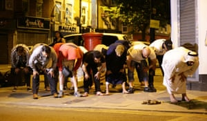 Local people observe prayers on the streets at Finsbury Park