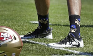 Colin Kaepernick saids he has been wearing socks depicting police officers as pigs in protest at 'rogue cops' who put the community and other officers at risk.