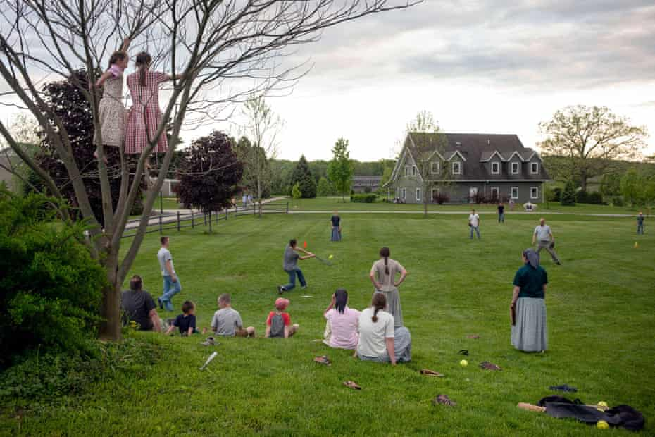 An impromptu community softball game comes together on the Foxhill community, Upstate New York