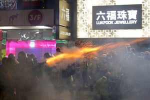 Policemen fire tear gas shells toward protestors in a shopping district of Hong Kong , August 31, 2019.