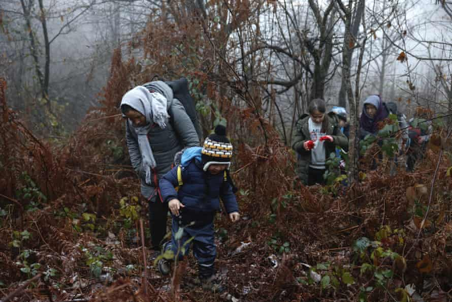 A group of migrants in a Croatian forest after crossing the Bosnia-Croatia border near the town of Velika Kladusa, in December 2020.