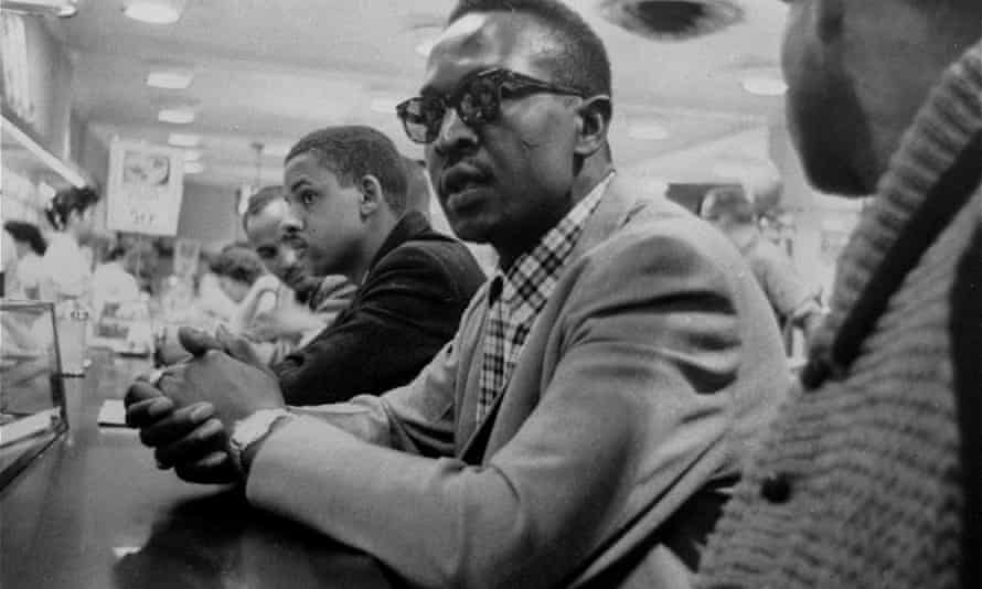 Not in the Green Book ... young black men take counter seats but wait in vain for food service at a store in Greensboro, North Carolina in 1960 as part of the civil rights movement.