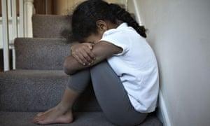 A model posing as an unhappy child