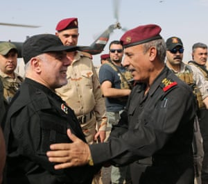 Iraqi prime minister Haider al-Abadi greets army officers in Mosul.