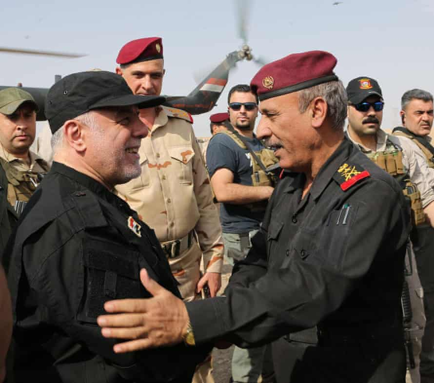 Iraqi prime minister Haider al-Abadi greets army officers in Mosul.