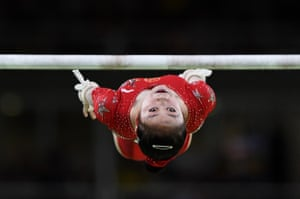 Jiaxin Tan of China competes on the uneven bars during women's qualification for Artistic Gymnatics.