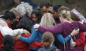 Stem school parents gather in a circle to pray after a shooting at the Highlands Ranch school.