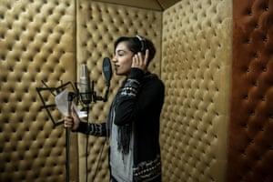 Hadeel Fawzy Abushar 25 records a song in a studio in Gaza City
