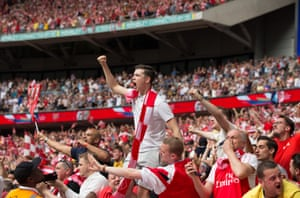 Arsenal fans celebrate the opening goal.