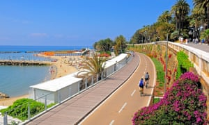 Sanremo sea front with beach and cyclists