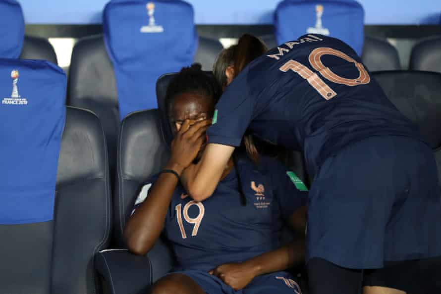 Amel Majri of France consoles teammate Griedge Mbock Bathy following France's defeat in the quarter final by USA at Parc des Princes.