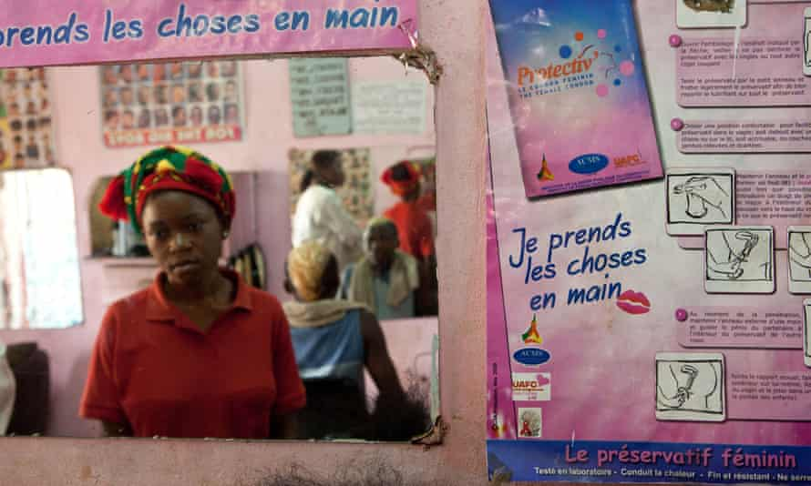 A women's hairdressing salon in Yaoundé, Cameroon, west Africa, with advertising for contraceptives
