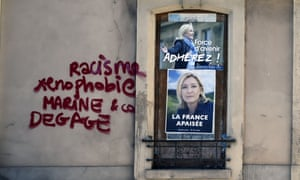 Graffiti on a FN campaign office reading 'Racism, xenophobia, Marine and co, clear off!'