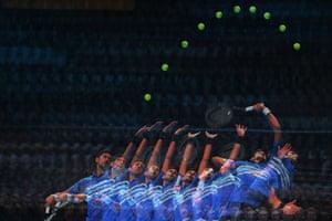 A multiple-exposure image shows the serve of Novak Djokovi.