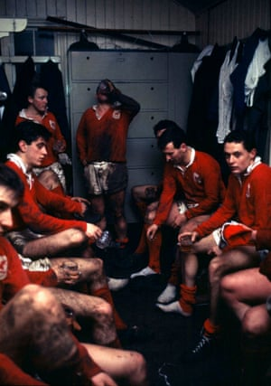 The London Welsh players enjoy a post match beer in the changing room following their match against London Irish in February 1964