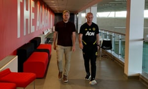 Academy head Nick Cox (left) with head of first-team development Nicky Butt. Cox devised the ways to keep the club's young players active and involved.