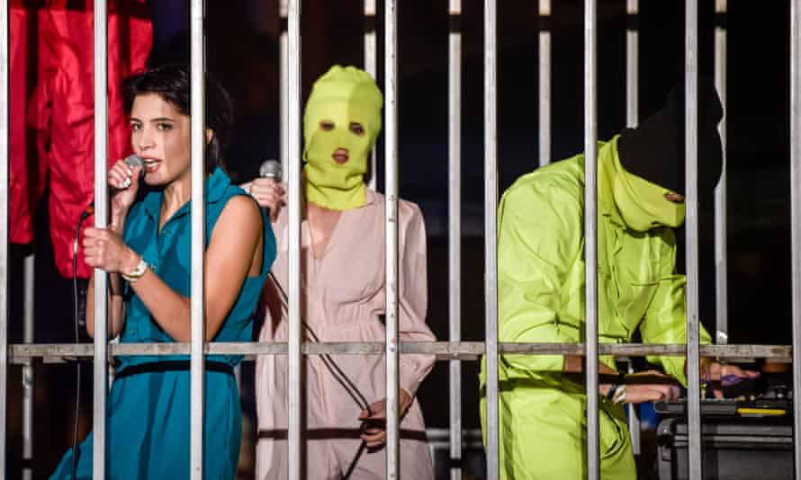 Pussy Riot perform in a metal cage at Banksy's Dismaland attraction in Western-super-Mare.