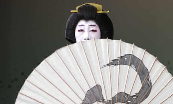 """A Japanese traditional female entertainer, or geisha, from Shimbashi area performs during a run-through before their actual show of """"Azumaodori"""" at Shimbashi Enbujo Theater Wednesday, May 22, 2019, in Tokyo. (AP Photo/Eugene Hoshiko)"""