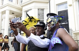 A police offer takes a selfie with performers