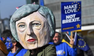 A protester in a Theresa May mask in Brussels