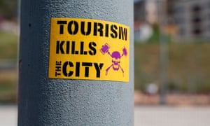 An anti-tourism sticker in Barcelona, where protests about the detrimental impact of tourists have taken place.