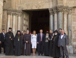 The US president and the first lady, Melania Trump, are greeted by priests and others as they arrive at the Church of the Holy Sepulchre in the Old City of Jerusalem
