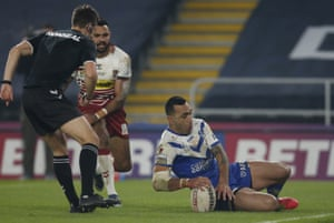 St Helens' Zeb Taia touches down but has his try disallowed.