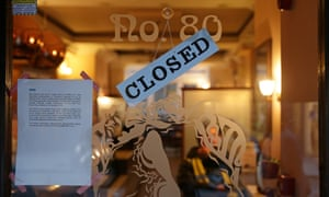 A sign at a closed-down branch of a Patisserie Valerie cafe in London declares the chain has been put into administration.