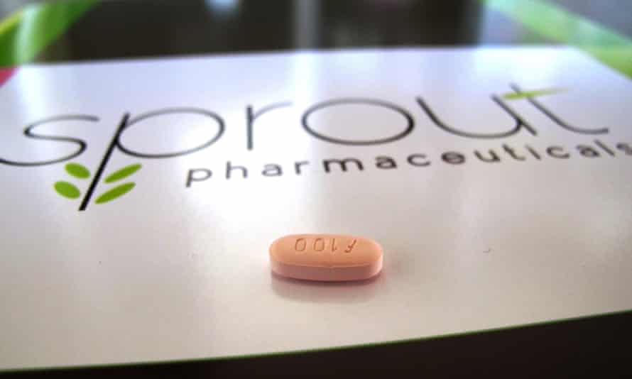 Flibanserin<br>FILE - In this Friday, Sept. 27, 2013, file photo, a tablet of flibanserin sits on a brochure for Sprout Pharmaceuticals in the company's Raleigh, N.C., headquarters. Sprout Pharmaceuticals, the makers of the twice-rejected pill intended to boost libido in women, will make a third attempt this week at convincing regulators to approve the drug as the first prescription treatment for low sexual desire in women. A panel of FDA experts will discuss the drug at a public meeting Thursday, June 4, 2015 before voting on whether to recommend its approval.(AP Photo/Allen G. Breed, File)