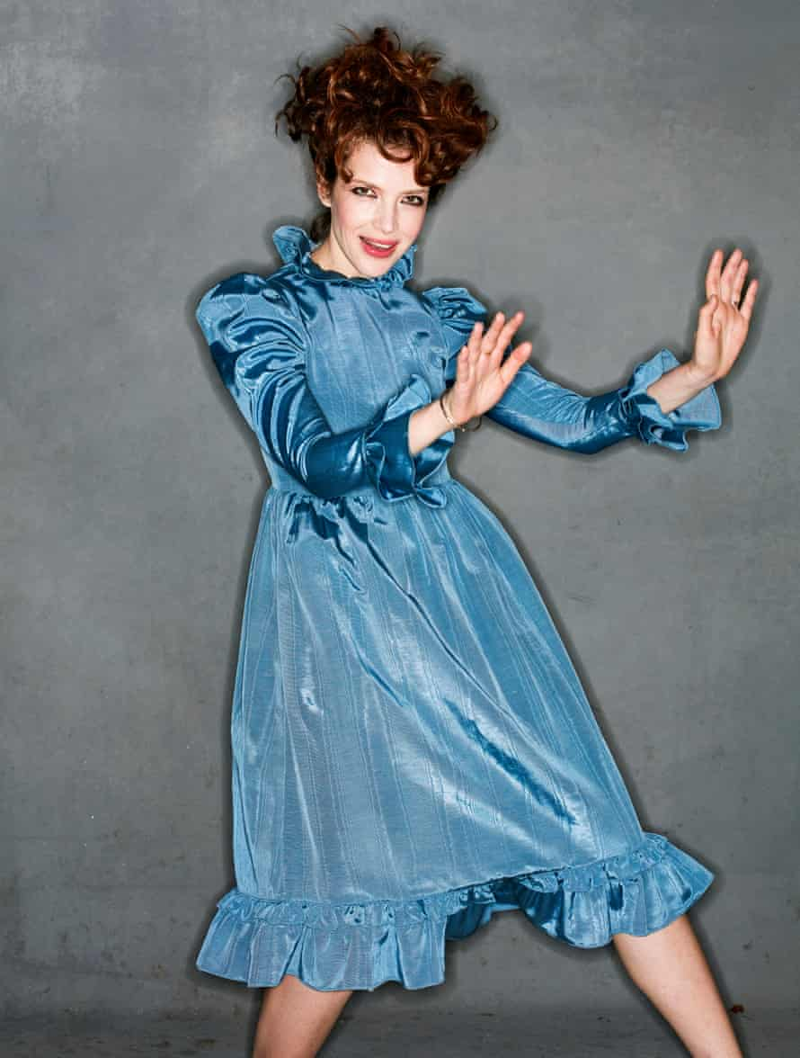 Batsheva in a blue glittery dress