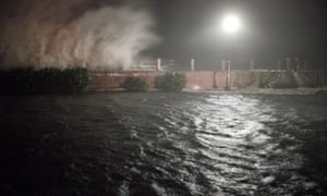 Storm surge and waves break over the sea wall in Charleston, South Carolina last night.