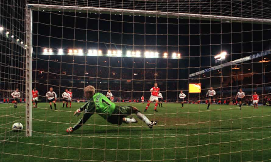 Dennis Bergkamp has a penalty saved by Peter Schmeichel.