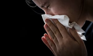 A man blows his nose