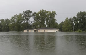 Remnants of Tropical Depression Imelda flood a home on Thursday near Devers, Texas.