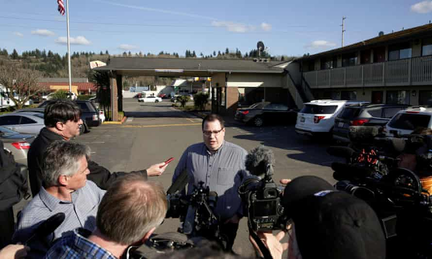 Chase Gallagher, a county official, addresses media after the county announced it is buying an 85-bed Econo Lodge motel to house patients in recovery and isolation for the coronavirus outbreak in Kent, Washington, U.S. March 4, 2020. REUTERS/Jason Redmond