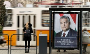 A poster featuring Hungarian Prime Minister Viktor Orbán hangs on a tram station