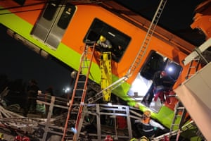 Rescue efforts were briefly interrupted at midnight because the partially hanging train was unstable and a crane had to be brought in