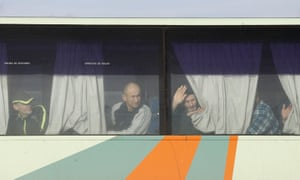 Prisoners look out from a bus before the exchange near the city of Bakhmut