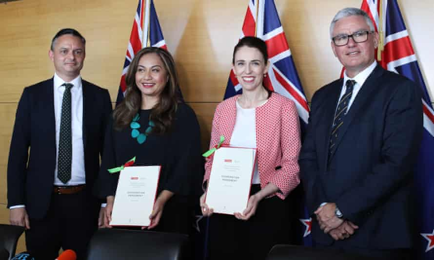 New Zealand Green party co-leaders James Shaw (far left) and Marama Davidson (second left) pose for a photo with Labour leader Jacinda Ardern and Labour deputy leader Kelvin Davis (R) after the two parties signed a cooperation agreement.