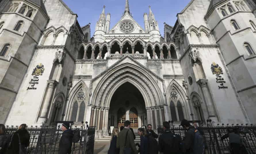 Media gather outside the high court in London