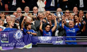 Chelsea players celebrate as the Women's FA Cup is lifted high.