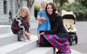 Prime Minister Jacinda Ardern says hello to the nieces of partner Clarke Gayford, Nina Cowan (L) and Rosie Cowan during her arrival at Parliament in Wellington.